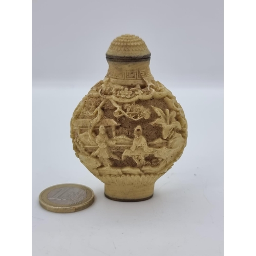 43 - A very pretty Chinese perfume bottle from the Victorian era. The piece is in carved ivory, with mark...