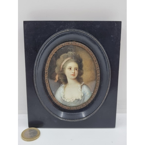 47 - A very striking, possibly French, hand painted portrait of a woman contained in an oval ebonized woo...