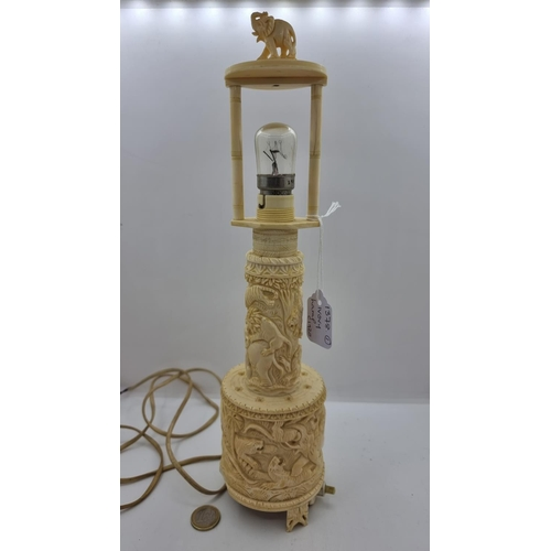 48 - A Victorian ivory two piece section table lamp, with extensive carved detail to the mount and base o...