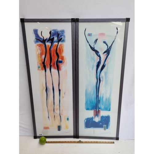 Pair of long framed prints showing abstract figure paintings. Very interesting pieces.