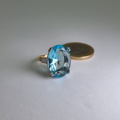 1 - A very attractive 18 carat yellow and white gold huge topaz ring, of step cut design in claw setting...