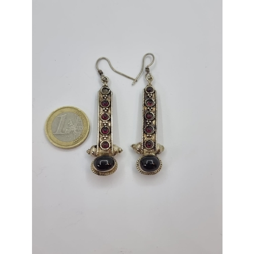 22 - A pair of vintage very attractive sterling silver pendant earrings, set with rubies and cabachon bla...