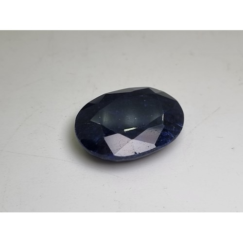 58 - A natural oval, mixed cut sapphire of 38.30 carats. A nice, clean stone with gemset certificate.