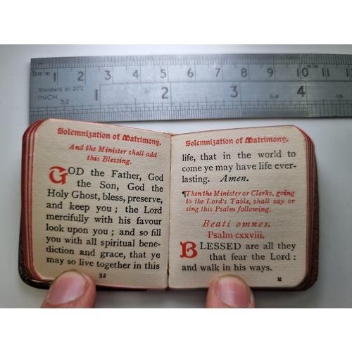 41 - A sterling silver wedding book, with cherub front  hallmarked London 1924. Maker's mark W. William S...
