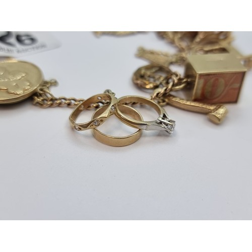 26 - A 9 carat gold 20 piece charm bracelet with lock key clasp and safety chain. Interesting collection ...