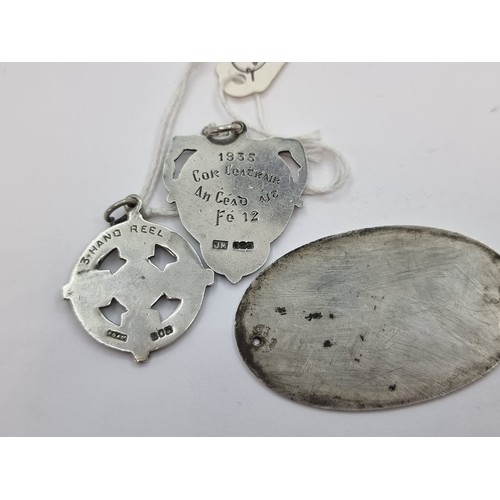 6 - A collection of three antique Irish  silver pieces, including two Irish medals for dancing - maker's...