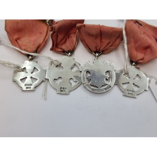 3 - A very interesting collection of four Irish silver medallions with ribbons. All in Celtic design. Ha...