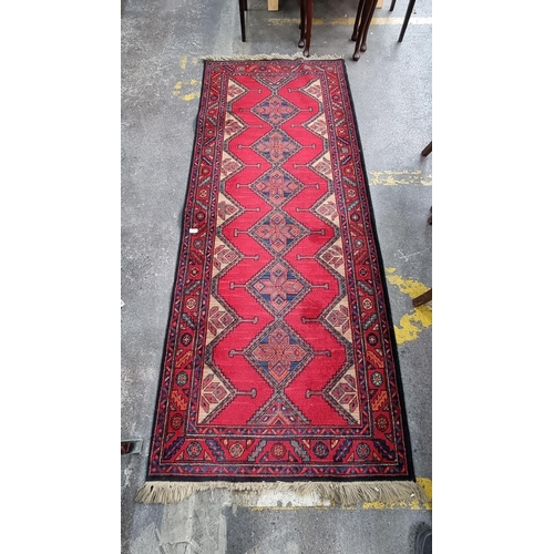 323 - Star Lot : Large Persian handmade, Hand Knotted and hand finished hall runner by Louis De Poortere M...