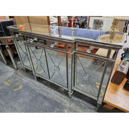 711 - Very large bevelled glass pedestal sideboard with four cabinet drawers and three drawers. Mm: 101 cm...