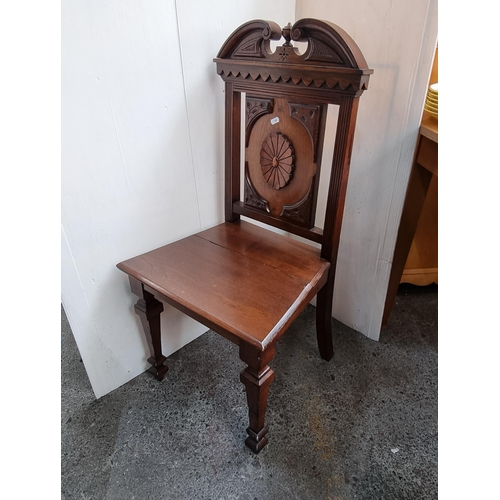 Beautiful 19th century  carved wooden hall chair with broken pediment top. Super clean example. Lovely piece.