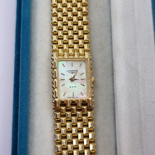 425 - A very nice example of a ladies Longines watch, featuring mother of pearl face. In presentation box....