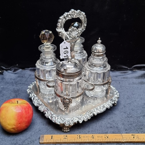 A beautiful George IV cruet set, circa 1840. Cut glass cannisters are topped with hallmarked silver caps or glass stoppers. Marked with TB & Co hallmark.