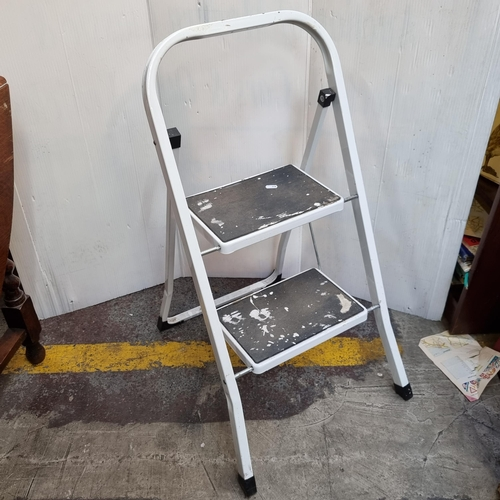 A neat-sized white step ladder (Two Steps)