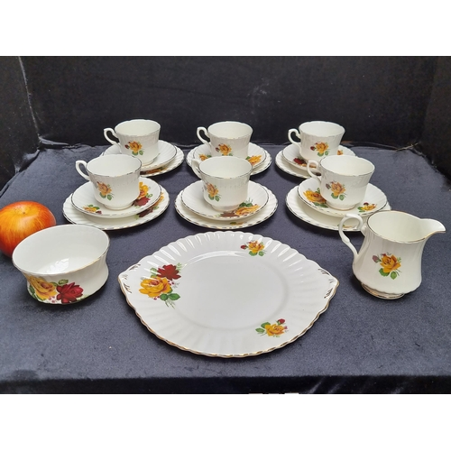 318 - 21 pieces of Royal Stafford Royal china in yellow and red rose design.