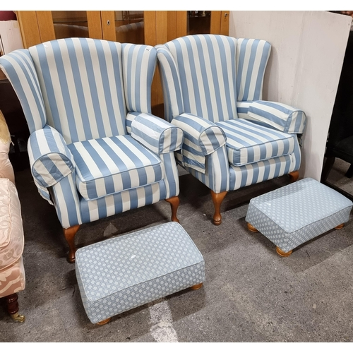 562 - Star Lot : A pair of heavy high wingback armchairs with two matching ottomans. Upholstered in blue c...