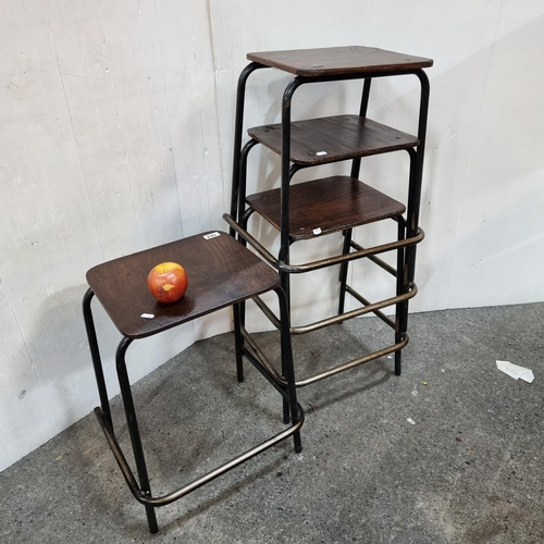 564 - Four vintage lab stools with heavy metal frame and wooden seat.