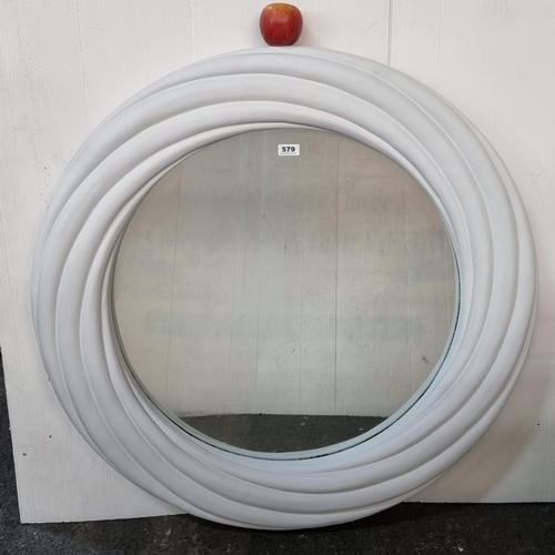 A very large and heavy circular wall mirror in a moulded plaster frame. Attractive curved details. 98cm in diameter. very high quality mirror.
