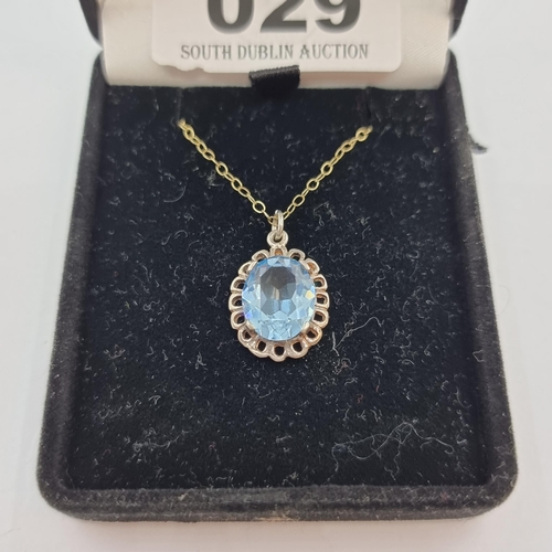 29 - A very nice example of a blue facet cut topaz stone (mounted on 9K gold), on a 9K gold chain. Stone ...