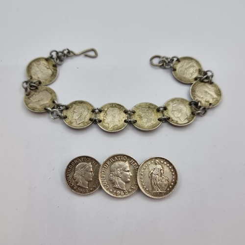 31 - Two sterling silver items, the first a seven threepenny piece bracelet (length 18cm). Together with ...