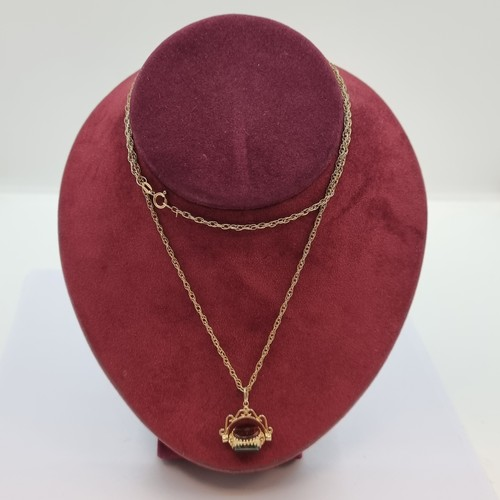 34 - A 9K gold swivel fob (featuring carnelian stones) on 9K gold chain. Length of chain 60cm. Weight of ...