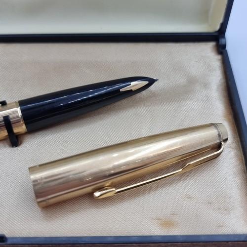 35 - A Large executive gold toned Parker pen with inscription