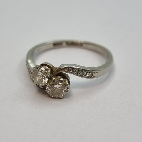 1 - Star Lot: Two stone twist diamond set ring with platinum band. Each diamond is a half carat, togethe...