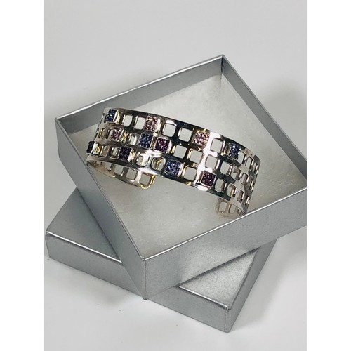 4 - 925 Silver modern bangle with purple and pink stones. 23.46 gr