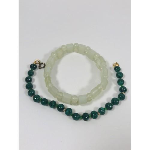 43 - 2 Jade bracelets. 1 vintage , 1 modern....