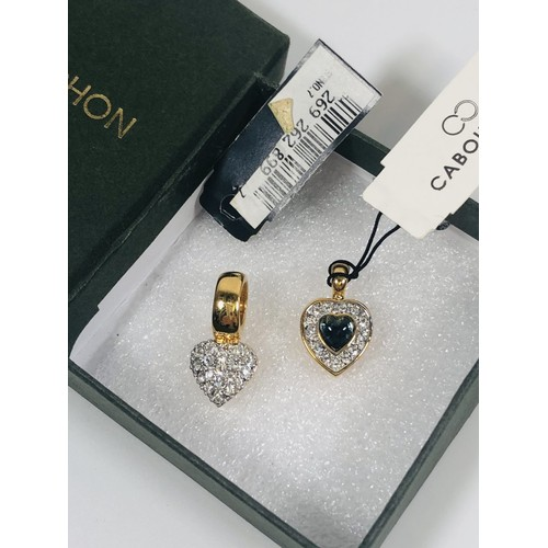 42 - 2 Cabouchon charms. Crystal set hearts....