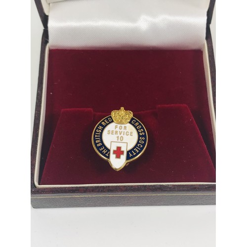 38 - British Red Cross Society brooch. For 10 years service. In presentation box.
