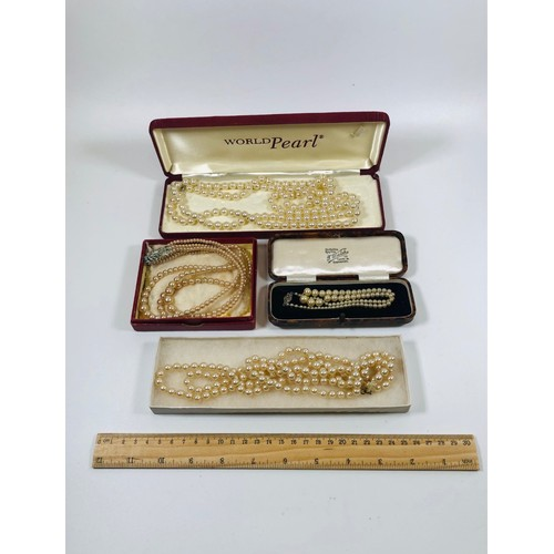 12 - Lot of old vintage pearls necklaces in display boxes....