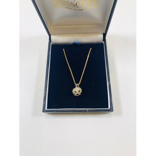 19 - Gold 9ct chain with Swarovski crystal ball pendant....
