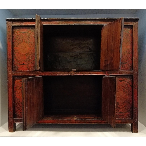 17 - CABINET - TIBET, LASHA - 19th CENTURY This cabinet was used in a house to store clothes and personal...