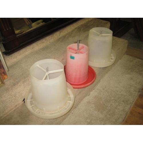 1062 - Three Plastic Poultry Feeders...