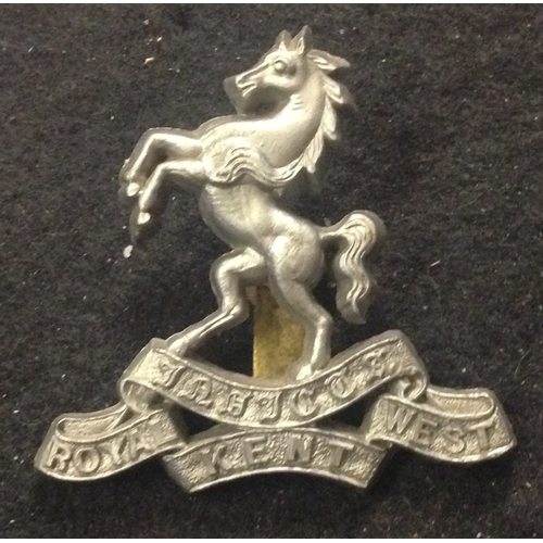 24 - <strong>Royal West Kent, War time economy plastic badge.</strong><br /><br />Not marked, but 2 tangs...