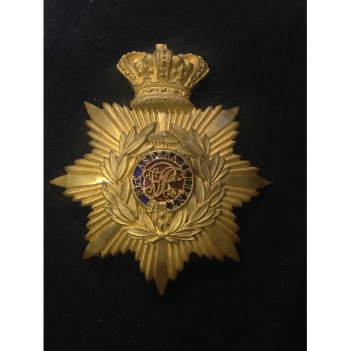 25 - <strong>Royal Military College, Cadets helmet Plate, Victoria Post 1881.</strong><br /><br />Gilded ...