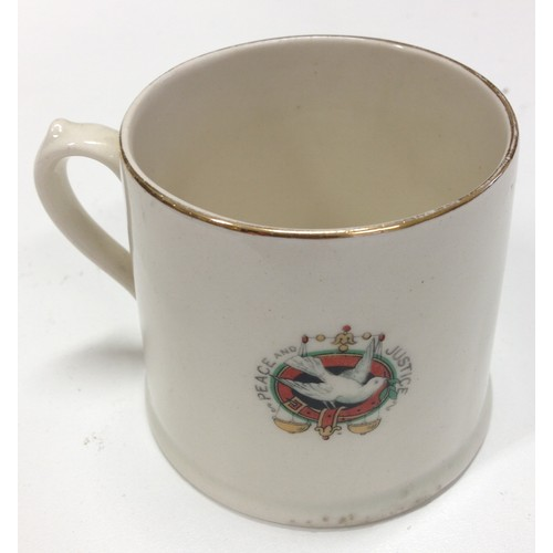 58 - <strong>The Great World War, Peace 1919 commemorative mug.</strong><br /><br />Flags of the allies ...