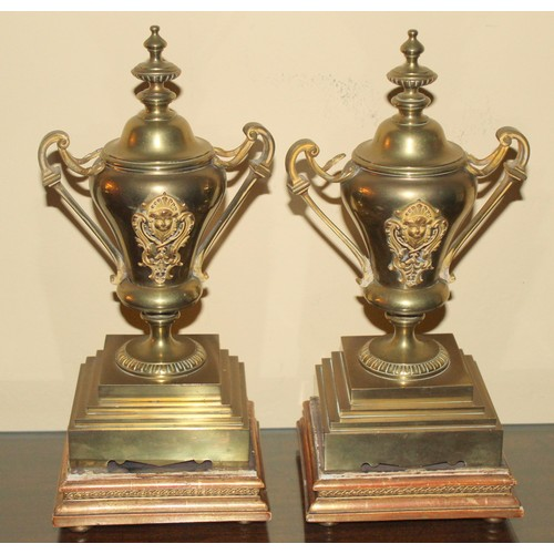 30A - Pair of Brass Urns with Finials on a base. 140mmW x 140mmD x 320mmH...