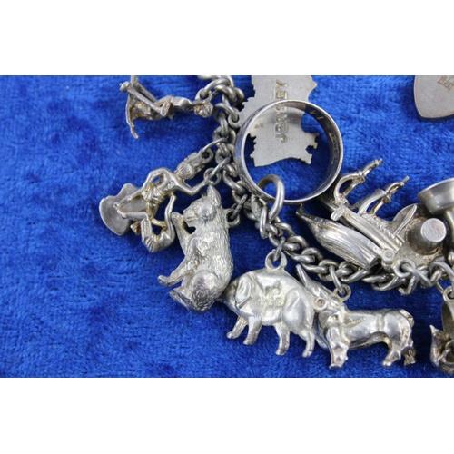 24 - Vintage sterling silver charm bracelet (83g)...