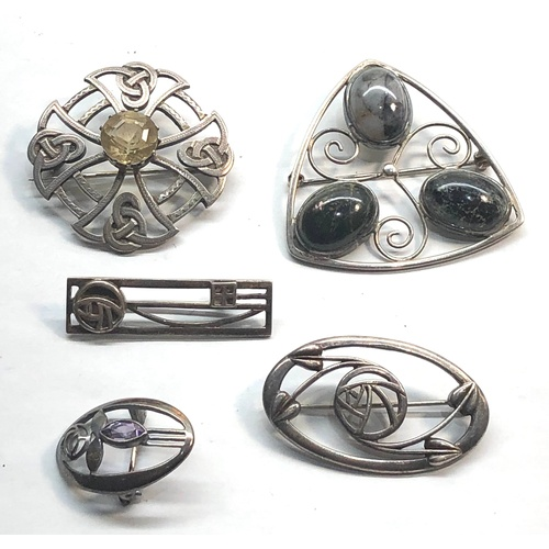 25 - 5 Silver celtic brooches...