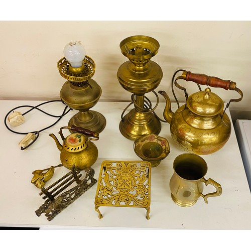 49 - Selection of brassware, includes brass lamps brass kettle etc...