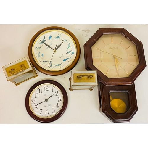 31 - Shelf of clocks all untested...