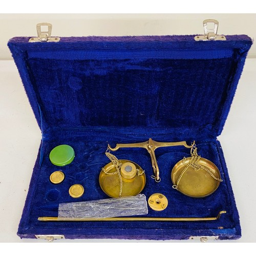 22 - Cased gold scales and weights...