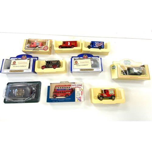 35 - Selection of 10 boxed die cast cars...