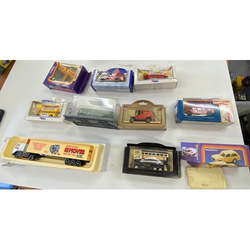 34 - Selection of 10 boxed die cast cars...