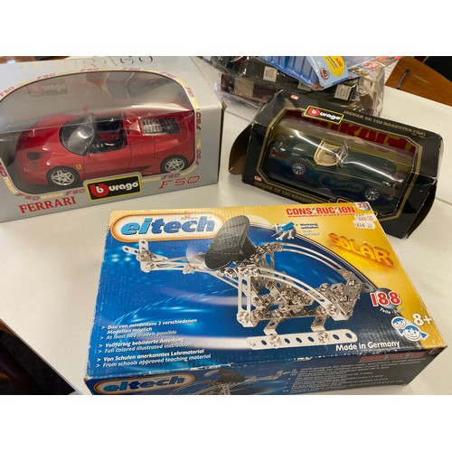 7 - 2 Boxed Burago cars and a eitech...