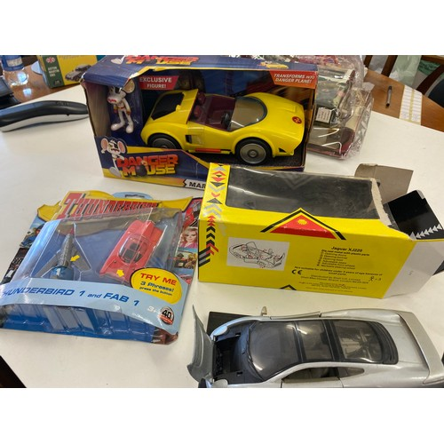 51 - 2 Boxed car, Danger mouse, Thunder birds and a Jaguar...
