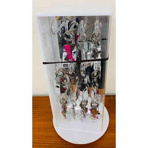 487 - playboy key rings and shop display case...