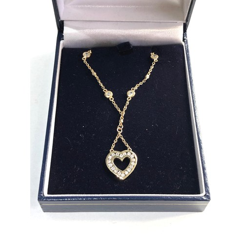 57 - 9ct gold CZ heart necklace...