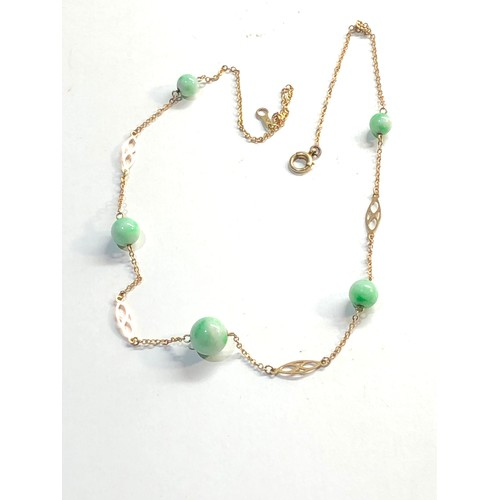 36 - 9ct gold jade necklace, overall good condition, largest jade bead measures approximately 9mm...